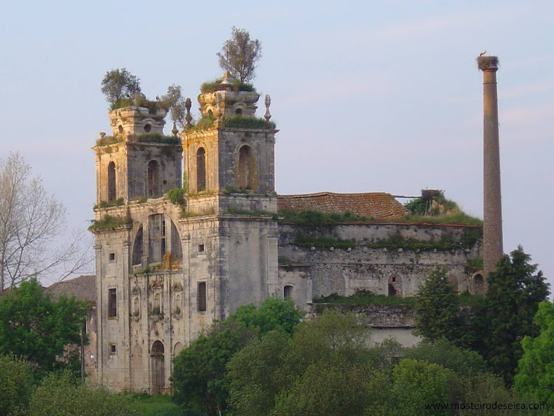 Spooky Place in Portugal, in Figueira da Foz. The scene is the end of the day, with sunset lighting on the building. There is a stone building with two towers in the front (like monasteries) and the roof is half destroyed. It is an abandoned building surrounded by nature.